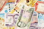 stock photo of pesos  - A mixed assortment of colorful Filipino Pesos - JPG