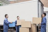 pic of movers  - Movers unloading moving van - JPG