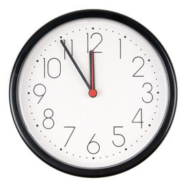 stock photo of analog clock  - Full isolated studio picture from a clock showing five to twelve - JPG