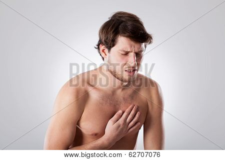 Naked Man Suffering From Chest Pain