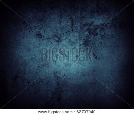 Blue grunge textured wall closeup