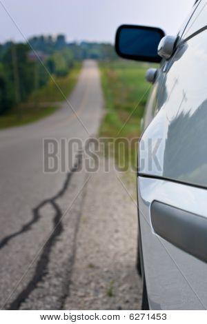 Car At Side Of Long Road