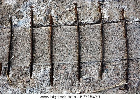 Grunge Concrete Wall With Rusty Armature