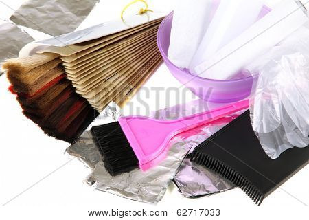 Hair dye kit and hair samples of different colors, isolated on white