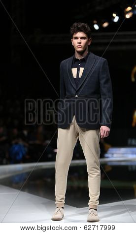 ZAGREB, CROATIA - MARCH 29: Fashion model wearing clothes designed by IK Studio on the 'Fashion.hr' show on March 29, 2014 in Zagreb, Croatia.