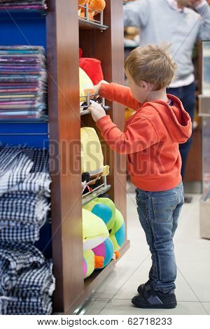 Cute little boy shopping for a beach accessories