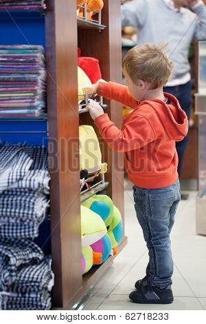 Cute little boy shopping for a beach accessories