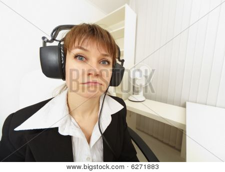 Comical Girl In Big Stereos Ear-phones