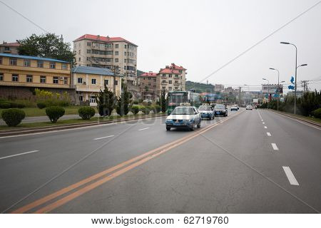 LUSHUN, CHINA - JUNE 10, 2012: Streets port city Lushun, russian name Port Arthur, is now a naval base in China. Here was the epicenter of the main events of the Russian-Japanese war of 1904-1905.