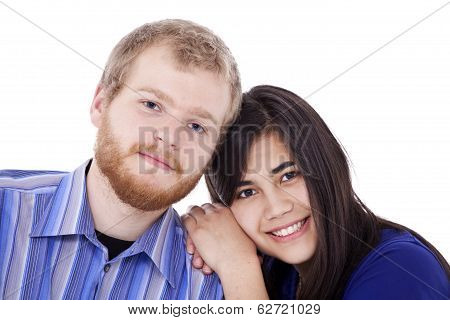 Happy Young Interracial Couple In Blue, Early Twenties Or Late Teens