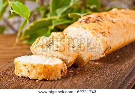 Fresh bread and butter on a wooden board