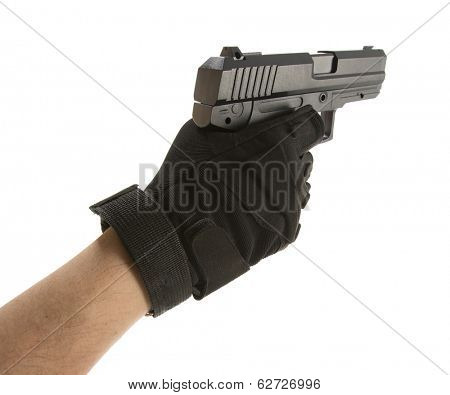Man's hand holding a pointing gun with a finger on the trigger