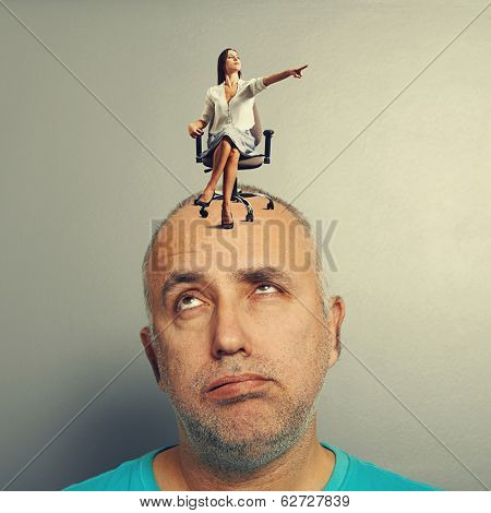 serious young woman pointing and screaming at tired man