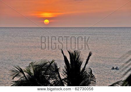 An orange Sun setting in Cuba