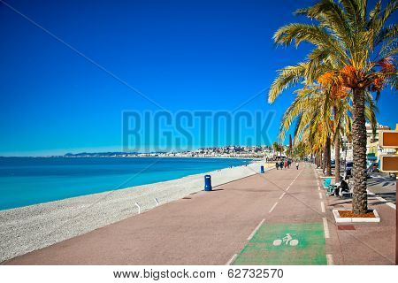 Promenade des Anglais in Nice, France. Nice is a popular Mediterranean tourist destination, attracting 4 million visitors each year.