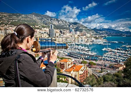 Beautiful woman looking at  Monte Carlo harbour in Monaco. Azur coast.