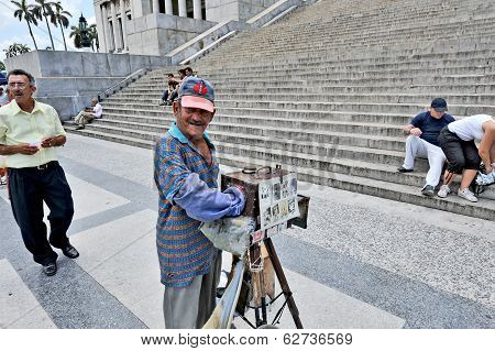 A man with an old box camera