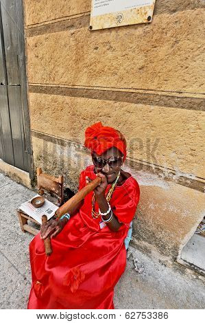 An old woman with a big cigar