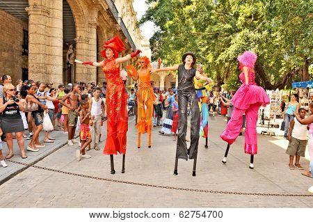 Performers dancing with wooden legs in Havana