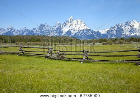 Rail Fence In Field Below Grand Teton Mountain Range