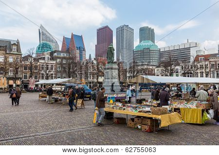 People At A Bookmarket in The Hague