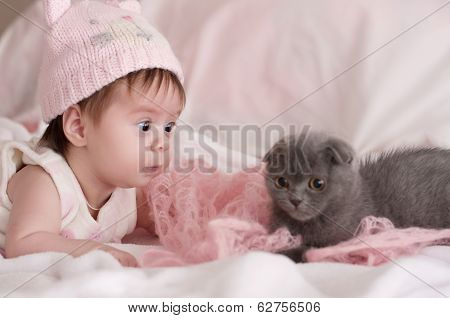 Cute girl in pink with a cat
