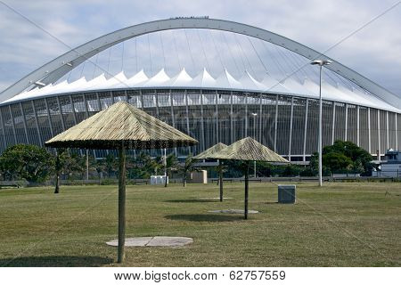 Sunshades On Grass In Front Of Staduim