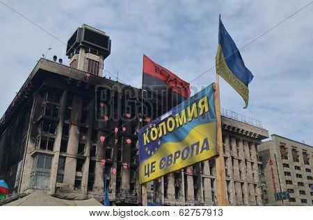 KIEV, UKRAINE -MAR 17, 2014: Poster - Kolomyia is Europe (Ukrainian).Downtow n of Kiev.Burnt down the House of trade unions Riot in Kiev and Western Ukraine.March 17, 2014 Kiev, Ukraine