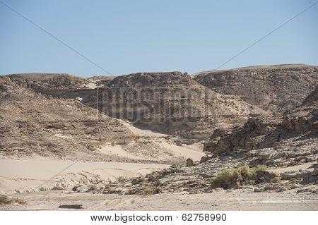 Dry River Valley Through A Rocky Desert