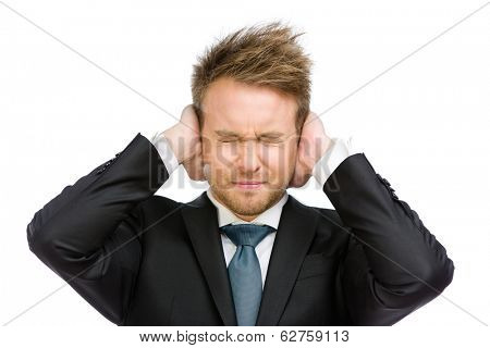 Half-length portrait of businessman with closed eyes closes his ears, isolated on white. Concept of noise and stress
