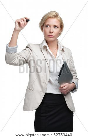 Pretty businesswoman writing on the invisible screen with marker, isolated on white. Successful work