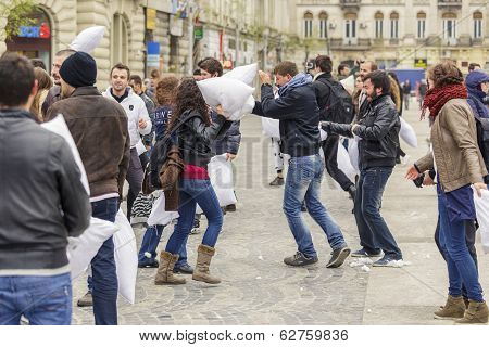 People Fighting With Pillows