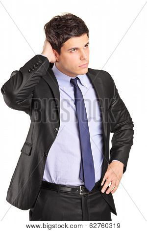Confused young businessman looking in the distance isolated on white background