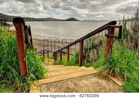 Wooden Steps Lead Down To Waters Edge