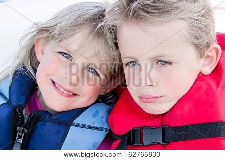 Brother And Sister In Life Jackets