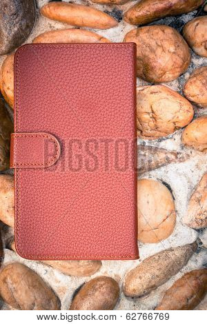 Smartphone leather case cover on gravel texture floor in vintage picture style