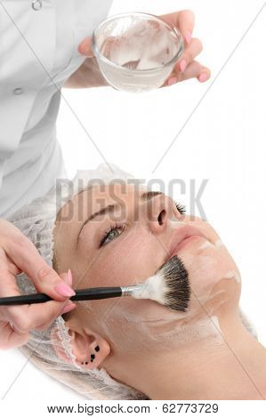 beauty salon, facial mask applying using brush