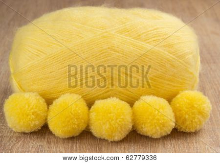 pompons and yellow yarn