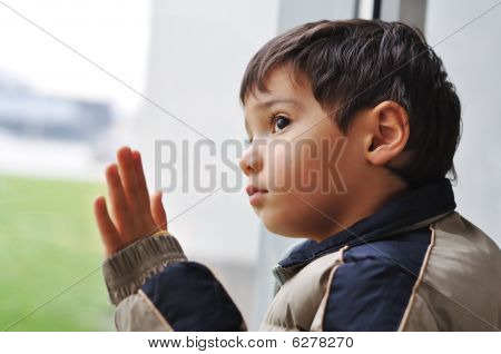 A Kid On The Window Waiting