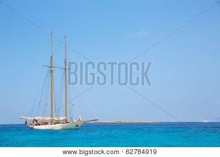 Illetes Illetas Formentera yacht sailboat anchored in turquise Mediterranean