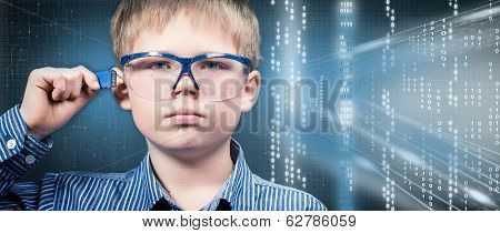 Smart boy in virtual glasses with memory card.