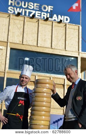 SOCHI, RUSSIA - FEBRUARY 12, 2014:  Nicolas Bideau, Head of Presence Switzerland (right) and the cook of Mosimann's restaurant against the House of Switzerland on the XXII Winter Olympics