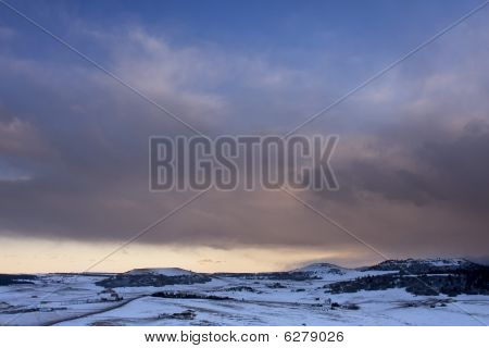Wintertime with snow at sunset in Larkspur, Colorado