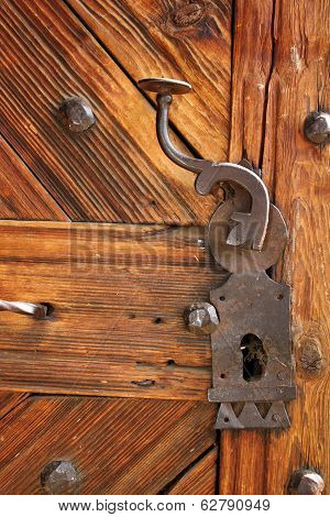 Ancient Latch On Beautiful Wooden Door