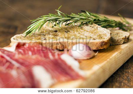 Bread Slices With Rosemary And Serrano Ham, Focus On Bread