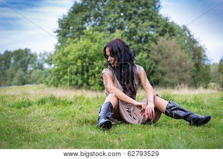 Elegant Attractive Woman Relax On A Meadow