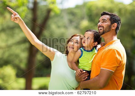 happy young indian family bird watching outdoors