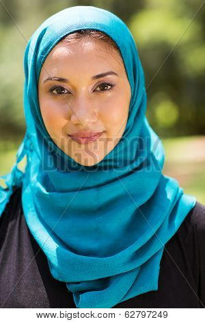 attractive Muslim woman closeup portrait outdoors