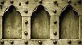Architecture. Closeup Of Wooden Door With Rivets As Background