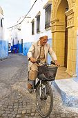 RABAT, MOROCCO - OCTOBER 15 2013: Arab man is biking in the medina of Rabat Morocco
